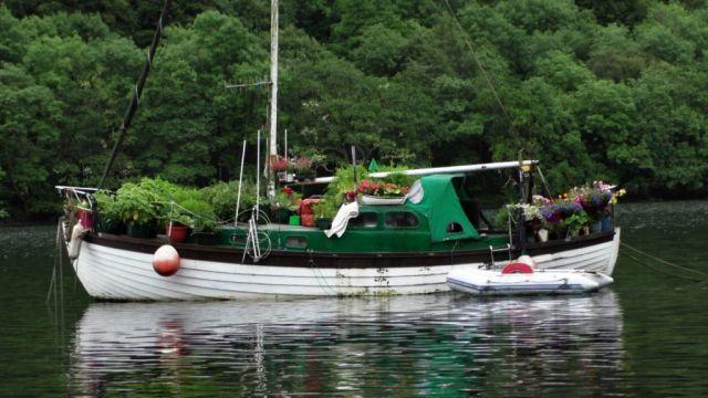 kEEPTURNINGLEFT-wooden-boat-doomed-by-fl
